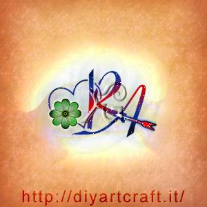 Lettere maiuscole RA intrecciate tra loro e al cuore caratterizzato dalla presenza di un quadrifoglio porta fortuna.