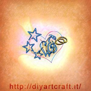 monogramma da fare in coppia lettere WE nel cuore con fedi nuziali e stelle.