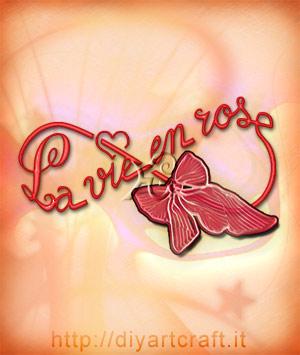 Bella frase in lingua francese disegnata su simbolo infinito con nastro rosa: La vie en rose in stile calligrafico.